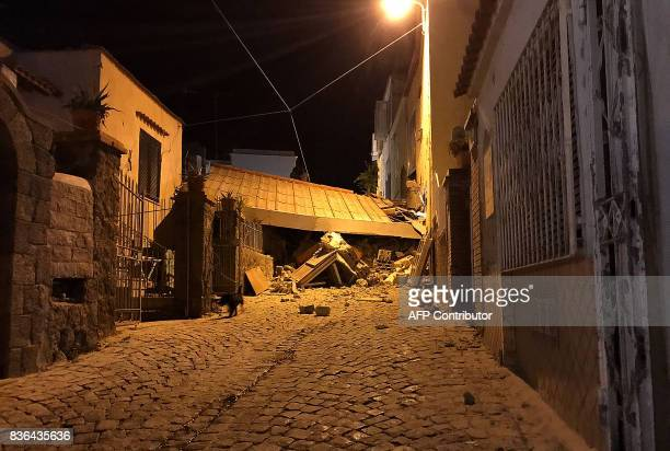 TOPSHOT An earthquake hit the popular Italian tourist island of Ischia off the coast of Naples causing several buildings to collapse on August 21...