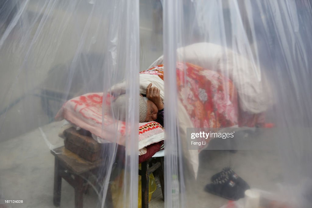 An earthquake old survivor sleeps in a tent on April 21, 2013 in Lushan of Ya An, China. A magnitude 7 earthquake hit China's Sichuan province on April 20 claiming over 160 lives and injuring thousands.