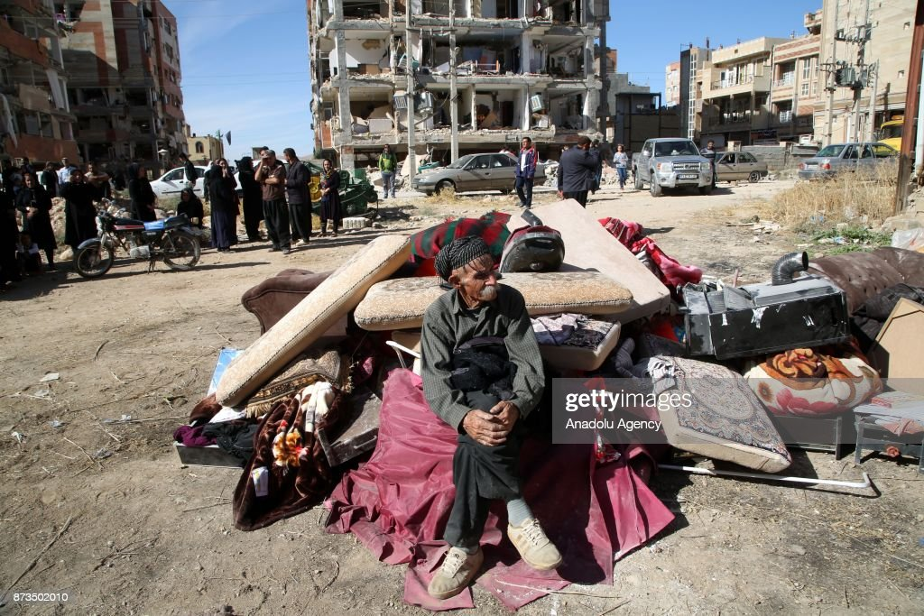 An earthquake survivor elderly man wait with his belongings at the outside of the damaged buildings in Sarpol-e Zahab town of Kermanshah, Iran on November 13, 2017 following a 7.3 magnitude earthquake that hit the Iraq and Iran. An earthquake measuring 7.3 on the Richter scale rocked northern Iraq and Iran, the U.S. Geological Survey said on Sunday evening. Turkish paramedic teams and rescue teams dispatched to the disaster area under the coordination of Turkish aid agencies; AFAD (Turkey's Disaster Management Agency) and Kizilay (Turkish Red Crescent). At least 211 died and 2,504 others were injured in Iran's bordering regions, especially in Kermanshah province in west.