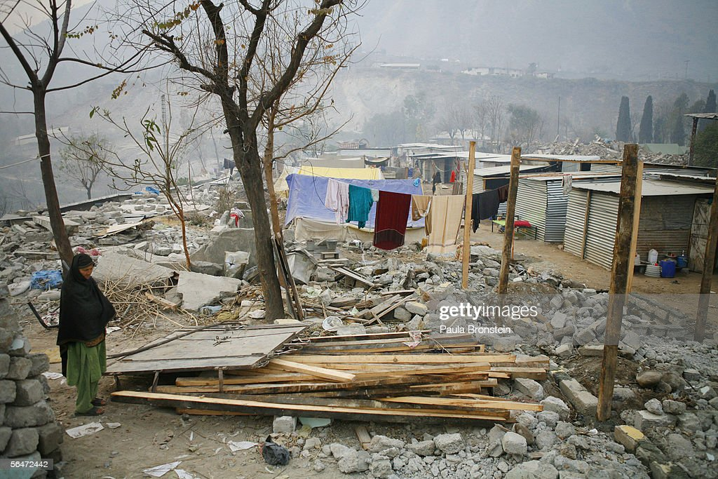 An earthquake survivor stands by the rubble and debris where her home once was December 20 2005 in Muzaffarbad Pakistan Lack of snow is giving the...
