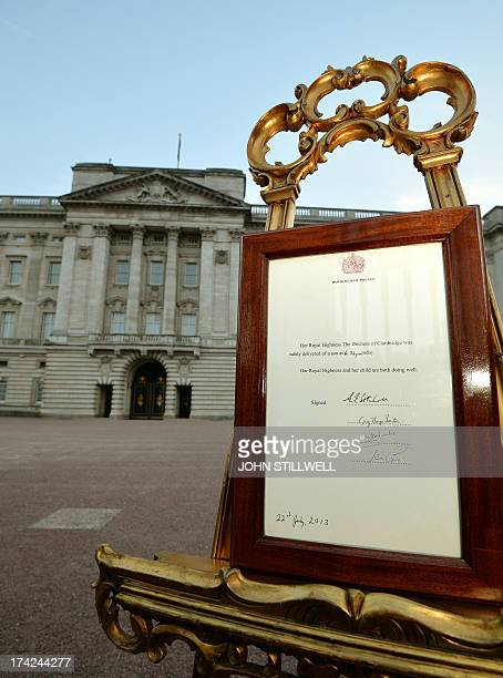 An easel stands in the forecourt of Buckingham Palace in London on July 22 to announce the birth of a baby boy at 424pm to Prince William and...