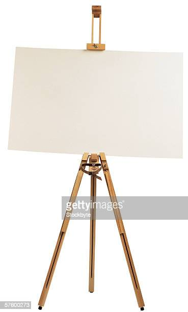 an easel with a white sheet