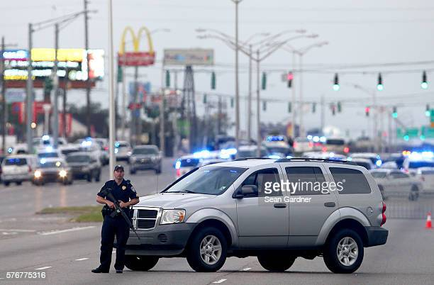 An East Baton Rouge Police officer patrols Airline Hwy after 3 police officers were killed early this morning on July 17 2016 in Baton Rouge...