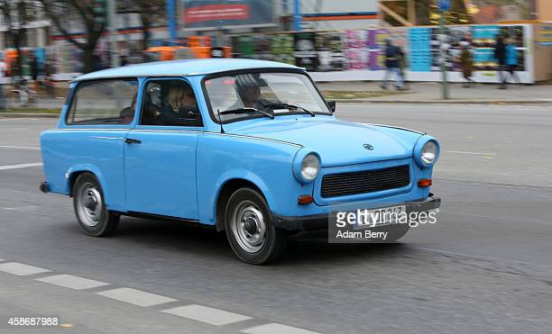 An East German or German Democratic Republic era Trabant automobile drives through Berlin during celebrations for the 25th anniversary of the fall of...