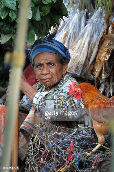An East Timorese woman looks on at a market in Dili on June 5 2013 As one of Asia's poorest nations East Timor economy has relied on outside help for...