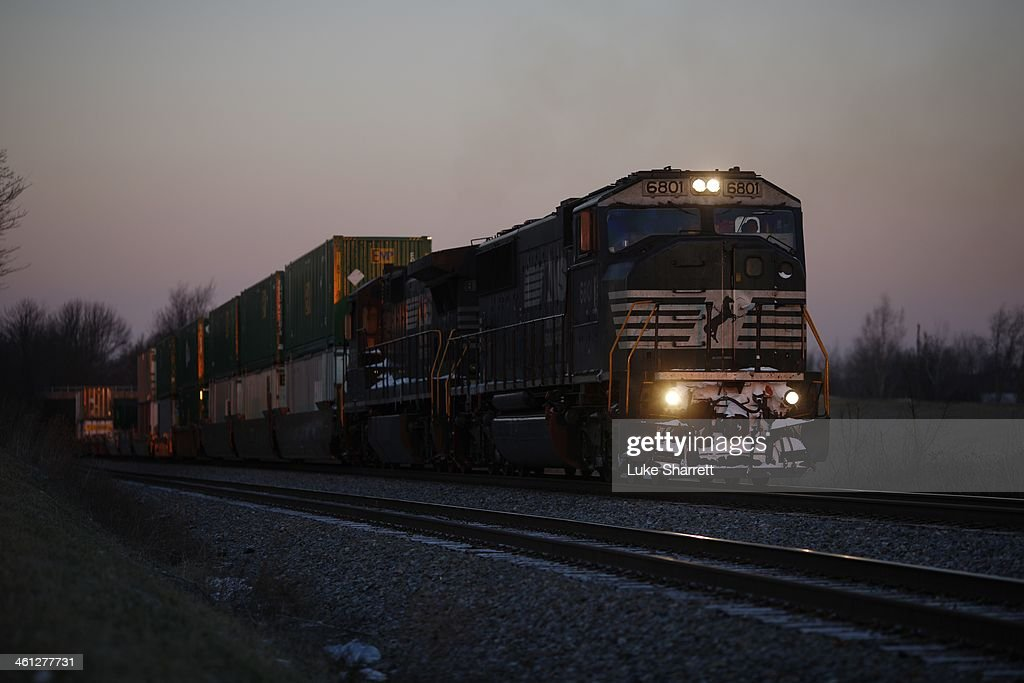 An Eastbound Norfolk Southern Corp intermodal freight train passes through at sunrise on January 7 2014 in Waddy Kentucky Intermodal rail traffic in...