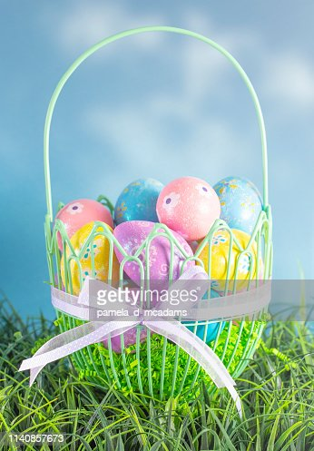 An Easter Basket Filled with Diecorated Eggs on a Clear Blue Sky Spring Day : Stock Photo