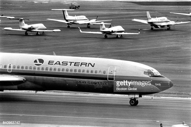 An Eastern Air Lines jet taxis toward a gate at Logan Airport in Boston on Mar 16 1988