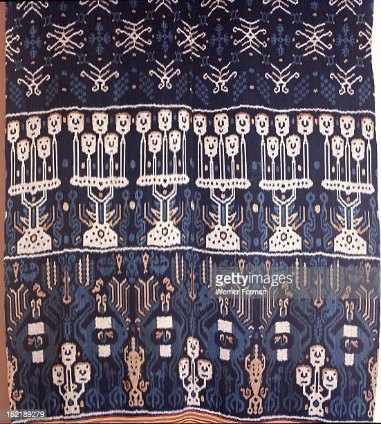 An Eastern Sumba noblemans mantle hinggi decorated by warp ikat dying the threads prior to weaving Among the details depicted can be seen horses...