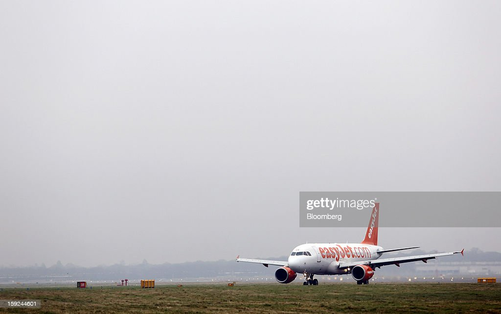 An Easyjet Plc aircraft taxis after landing at Gatwick airport in Crawley, U.K., on Thursday, Jan. 10, 2013. Gatwick, acquired by Global Infrastructure Partners Ltd. in 2009 after regulators sought a breakup of BAA Ltd., owner of the larger Heathrow hub, is 30 miles (48 kilometers) south of London and serves about 200 destinations, more than any other U.K. airport, according to flight schedule data provider OAG. Photographer: Chris Ratcliffe/Bloomberg via Getty Images