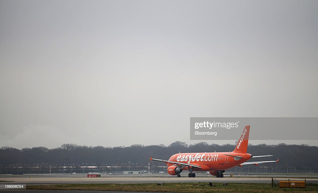 An Easyjet Plc aircraft taxis towards the runway at Gatwick airport in Crawley, U.K., on Thursday, Jan. 10, 2013. Gatwick, acquired by Global Infrastructure Partners Ltd. in 2009 after regulators sought a breakup of BAA Ltd., owner of the larger Heathrow hub, is 30 miles (48 kilometers) south of London and serves about 200 destinations, more than any other U.K. airport, according to flight schedule data provider OAG. Photographer: Chris Ratcliffe/Bloomberg via Getty Images