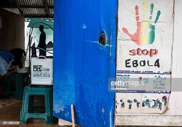 An ebola prevention poster sits outside an Ebola Treatment Center at Wankifong Guinea on Thursday Sept 10 2015 An Ebola epidemic and a slump in...