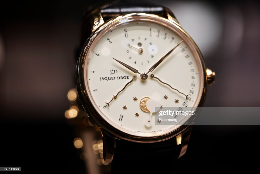 An Eclipse Ivory Enamel wristwatch, manufactured by Jaquet Droz, a unit of Swatch Group AG, sits on display during the Baselworld watch fair in Basel, Switzerland, on Wednesday, April 24, 2013. The annual fair attracts 2,000 companies from the watch, jewelry and gem industries to show their new wares to more than 100,000 visitors. Photographer: Gianluca Colla/Bloomberg via Getty Images