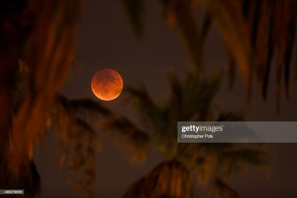 An eclipsed supermoon is shown on September 27, 2015 in Los Angeles, California. A supermoon occurs when a full moon coincides with its perigee, which is its closest approach to the Earth. A total lunar eclipse and a supermoon won't occur together again until 2033.
