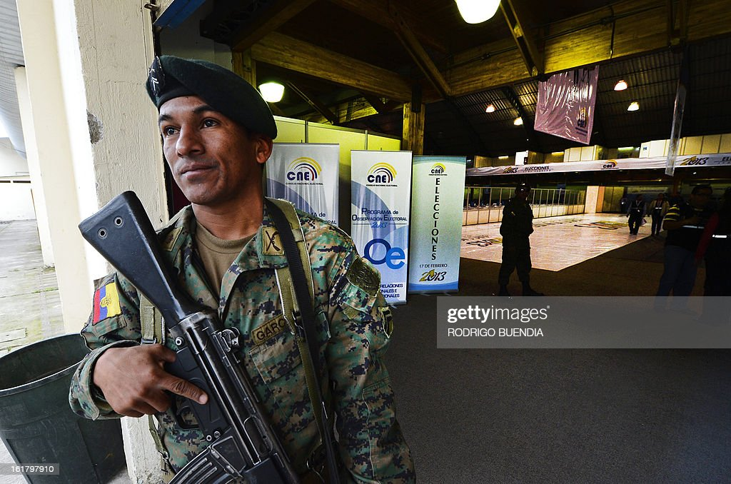 An Ecuadorean soldier stands guard at the vote counting centre, on the eve of general elections in Quito on February 16, 2013. Almost 12 million people are eligible to vote in Ecuador's presidential election, with President Rafael Correa tipped to win re-election by a landslide.