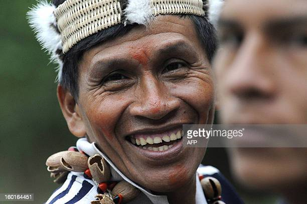 STORY An Ecuadorean Waorani native smiles during a ceremony at the Yasuni National Park at the Ecuadorean Amazon forest on August 21 2010 AFP PHOTO /...
