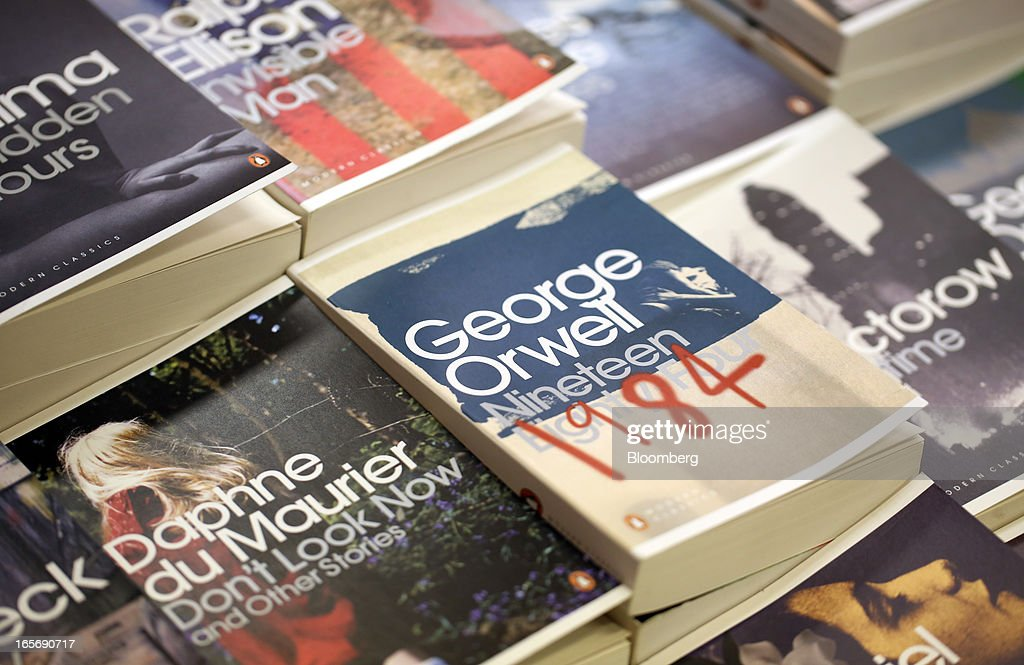 An edition of '1984' by George Orwell, right, is displayed among other Penguin books, part of Pearson Plc, at a bookstore in London, U.K., on Friday, April 5, 2013. Bertelsmann SE's Random House won European Union approval to buy Pearson Plc's Penguin unit to create the largest book publisher in the U.K. and the U.S. Photographer: Chris Ratcliffe/Bloomberg via Getty Images