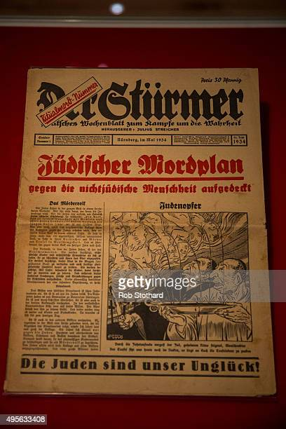 An edition of the Nazi propaganda publication Der Sturmer from May 1 is displayed as part of the 'Blood' exhibition at Jewish Museum London on...