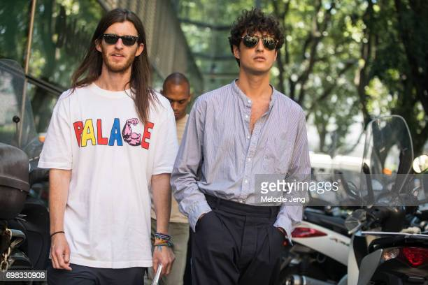 An editor wears a PALACE shirt with Giovanni Dario Laudicina during Milan Men's Fashion Week Spring/Summer 2018 on June 19 2017 in Milan Italy