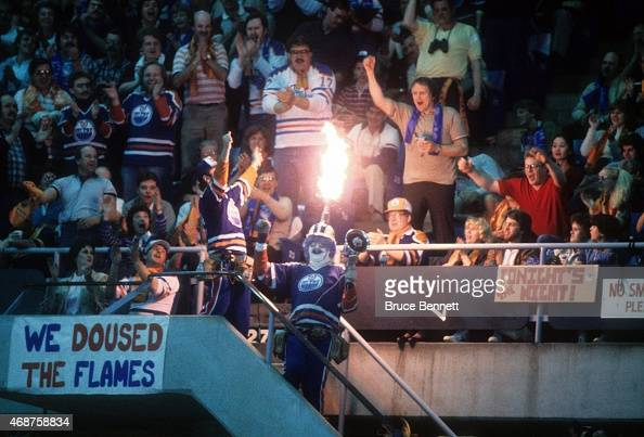 An Edmonton Oilers fan holds a megaphone and shoots flames out of his hat which is a small Stanley Cup replica during the 1985 Stanley Cup Finals...