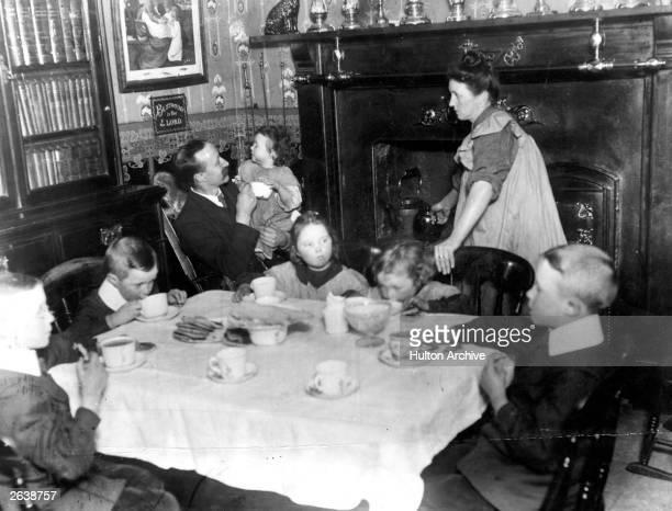 An Edwardian family having tea