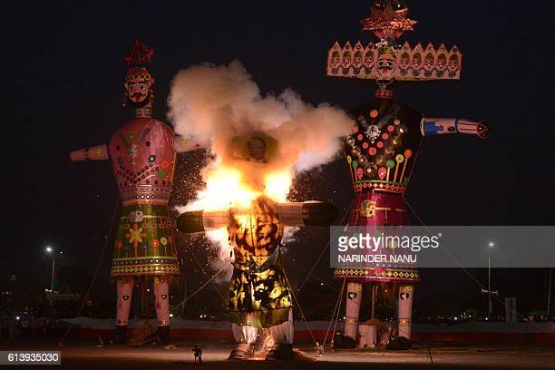 An effigy bearing the image of Pakistan's Prime Minister Nawaz Sharif in the likeness of Ravana the Hindu demon king stuffed with firecrackers burns...