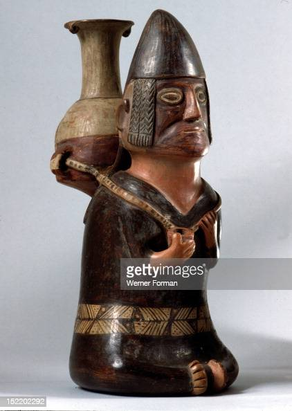 An effigy ceramic showing a male figure carrying the Inca aryballus on his back In his hand is a small container possibly for coca leaves Peru Inca...