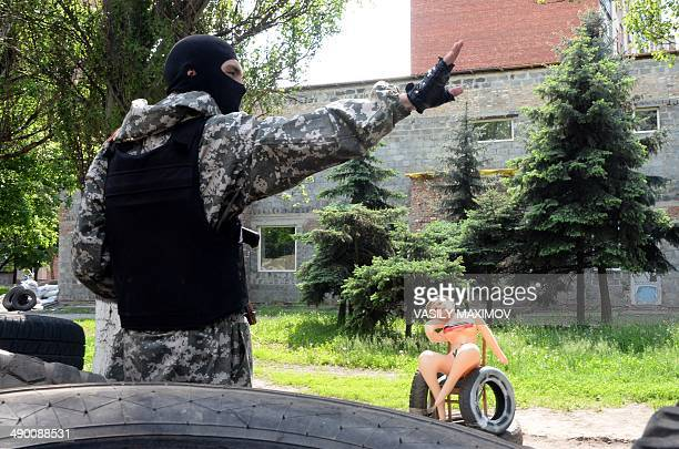 An effigy depicting one of the Ukrainian leaders Yulia TimosheNko is on a barricade in the eastern Ukranian city of Slavyansk on May 13 2014 Europe...