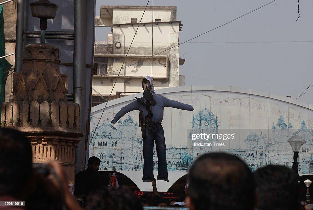 An effigy of terrorist Ajmal Kasav is hanged in public at Chhatrapati Shivaji Terminus (CST) on November 21, 2012 in Mumbai, India. Terrorist Ajmal Kasab sentenced to death for his role in November 26, 2008 terror attack on Mumbai was hanged to death at Yerwada Jail on November 21, 2012 in Pune, India.