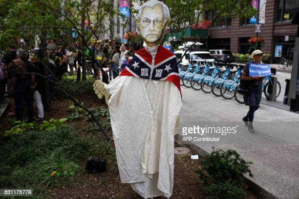 An effigy of Attorney General Jeff Sessions is displayed on a tree during a vigil August 13 2017 in Chicago Illinois for the victims in the previous...