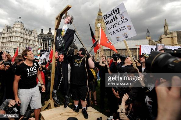 An effigy of Britain's Liberal Democrat leader Nick Clegg is hung in Parliament Square during a May Day demonstration in central London on May 1 2010...