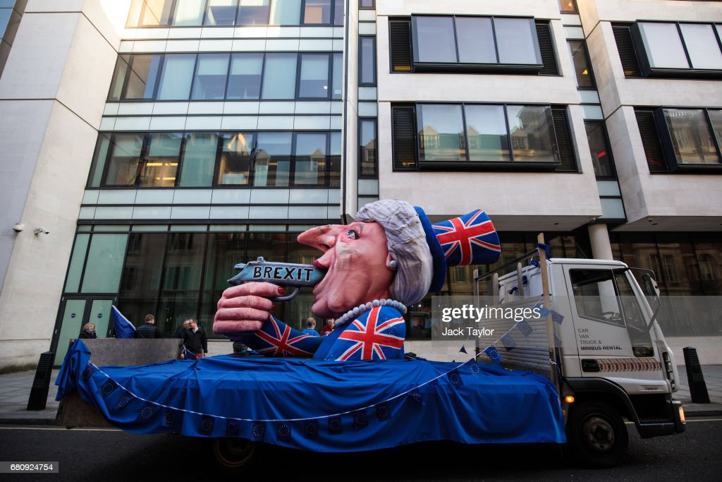 An effigy of British Prime Minister Theresa May with a gun sits outside BBC's Broadcasting House as Mrs May and her husband Philip May give a joint interview on the One Show on May 9, 2017 in London, England. Campaigning is underway ahead of the June 8th general election.