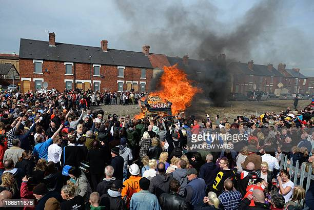 An effigy of former British prime minister Margaret Thatcher in a 'coffin' is burnt together with a sofa and wood as people gather to celebrate the...