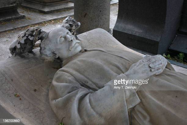 An effigy of French author and dramatist Alexandre Dumas fils on his grave at Montmartre Cemetery Paris 27th May 2011