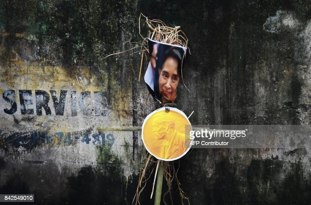 An effigy of Myanmar's civilian leader and Nobel peace laureate Aung San Suu Kyi with a Nobel prize medal is pictured at a rally to protest the...