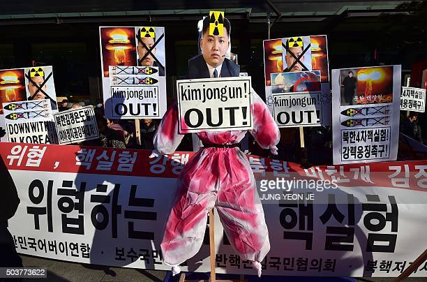 An effigy of North Korean leader Kim JongUn is set during a rally denouncing North Korea's hydrogen bomb test in Seoul on January 7 2016 The US and...