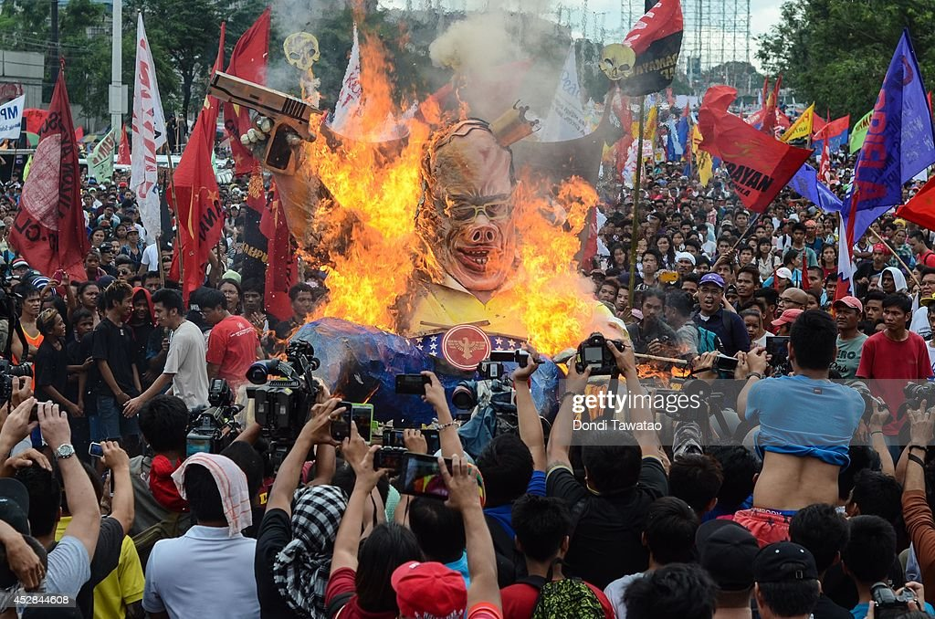 An effigy of President Benigno Aquino's is burned by protestors during his annual State of the Nation Address on July 28, 2014 in Manila, Philippines. Thousands of government protestors staged a rally to protest the alleged corruption of Aquino involving the Disbursement Allocation Programme, a 145-billion-peso ($3.34-billion) fund to boost public spending but some of the funds went to favored allies in the Lower House of Representatives, reports say.