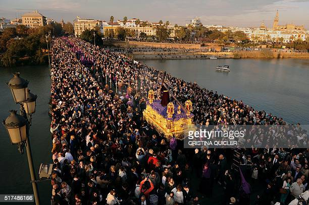 An effigy of the Christ of the 'La O' brotherhood is carried during an Easter procession in Sevilla on March 25 2016 Christian believers around the...