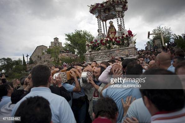 An effigy of the virgin Morenita displayed on a float is carried during the 'Romeria de la Virgen de la Cabeza' annual Romeria pilgrimage in Andujar...