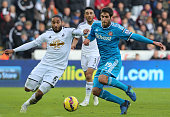 An effort by Danny Graham of Sunderland is cut out by Ashley Williams of Swansea City during the Barclays Premier League match between Swansea City...