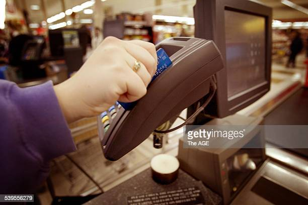 An EFTPOS machine at a Coles Myer supermarket 18 September 2003 The Age Picture by JOE ARMAO