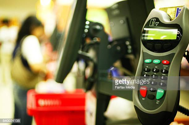 An eftpos machine at a register in a Coles Supermarket on 24 October 2005 AFR Picture by LOUIE DOUVIS