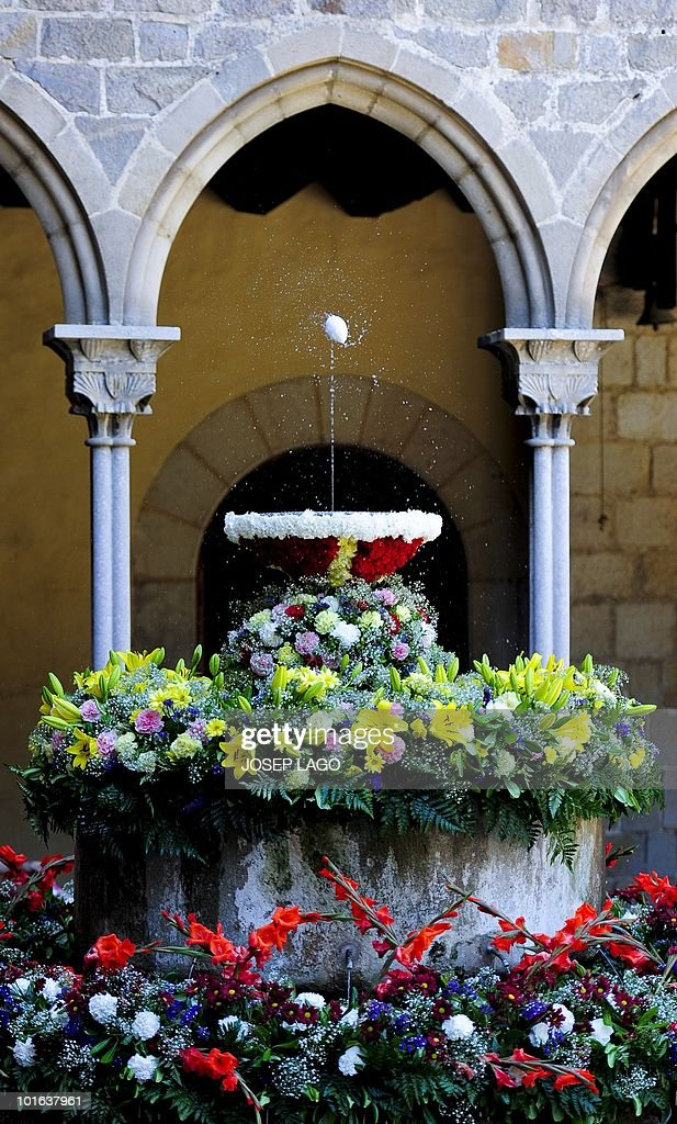 An egg hangs in the air from the force of a jet of water from a fountain in Pedralbes monastery in Barcelona on June 05 2010. The dancing egg, or 'L'ou com balla' in Catalan is a Corpus Christi tradition dating back to the the sixteenth century. The egg is emptied and wax is added as a counterweight, which when positioned over the fountain starts turning without falling. The surround are usually decorated with flowers and fresh fruits, such as cherries.