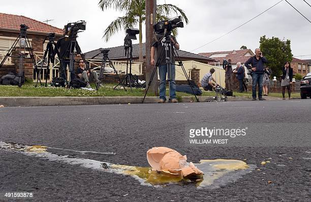 An egg lies on the road after many were hurled at media outside a house as four people were arrested over the terrorlinked murder of a police...