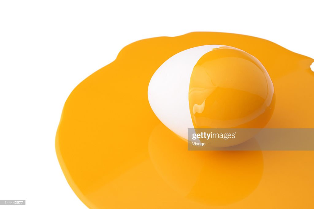 An egg painted half yellow : Stock Photo