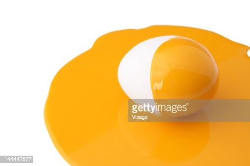An egg painted half yellow : ストックフォト