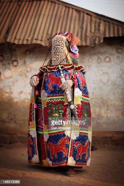 An 'Egungun' spirit stands during a Voodoo ceremony on January 11 2012 in Ouidah Benin The Egungun are masqueraded dancers that represents the...