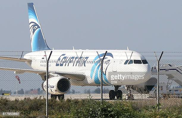 An EgyptAir Airbus A320 sits on the tarmac of Larnaca airport after it was hijacked and diverted to Cyprus on March 29 2016 / AFP / STR