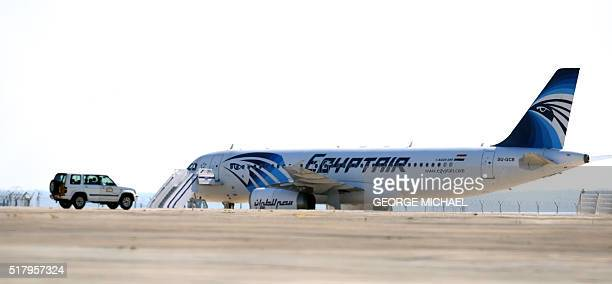 An EgyptAir Airbus A320 sits on the tarmac of Larnaca airport after it was hijacked and diverted to Cyprus on March 29 2016 A hijacker seized the...