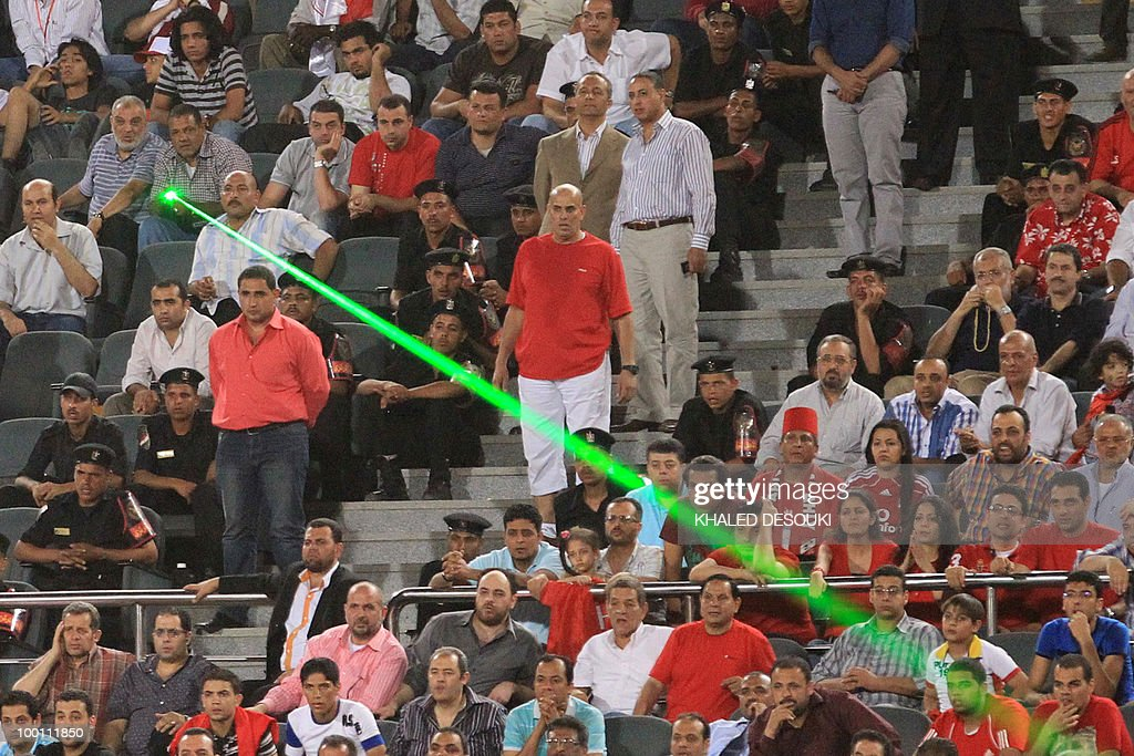 An Egyptian Al-Ahly's fan directs a laser light over the Libyan Al-Ittihad goalkeeper Samir Aboud during their African Champions League third round second leg football match in Cairo on May 9, 2010. Al-Ahly won 3-0.